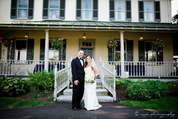 Bride and Groom In Front of Historic Manor