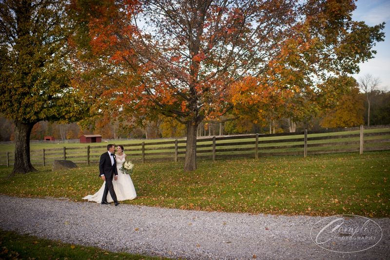bride and groom walking the grounds of SMF in the fall