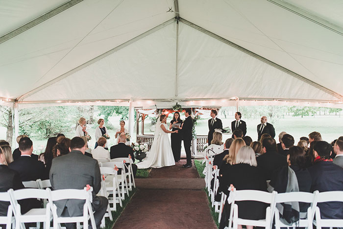 Ceremony Under Tent during Wedding Rain Plan