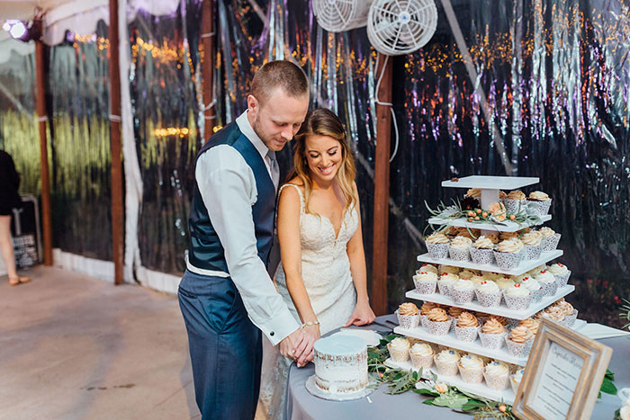 Bride and Groom Cut Cake Topper at Outdoor Wedding