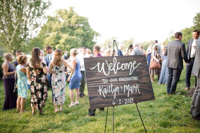 Custom-Made Wood Signage at Outdoor Wedding
