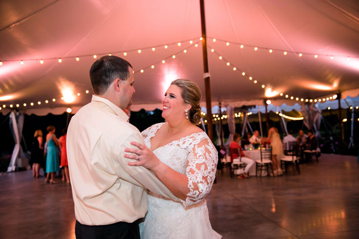 Tented String Lighting at Outdoor Wedding Couple