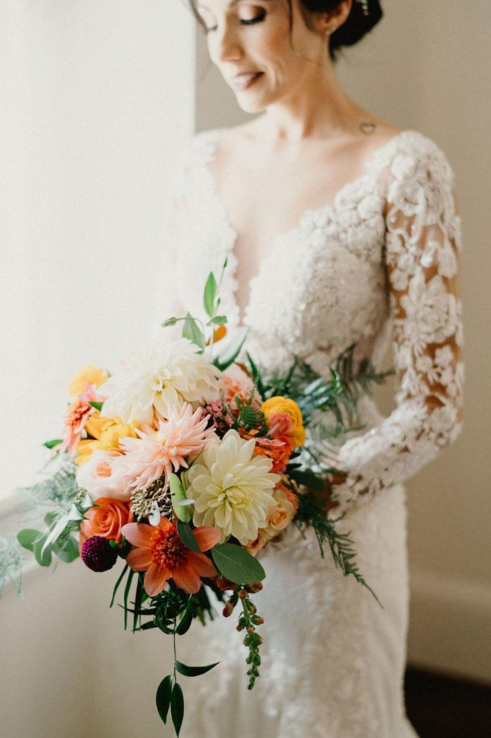 Boho Bride holding Wedding Bouquet